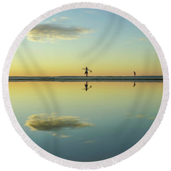 Woman And Cloud Reflected On Beach Lagoon At Sunset Round Beach Towel