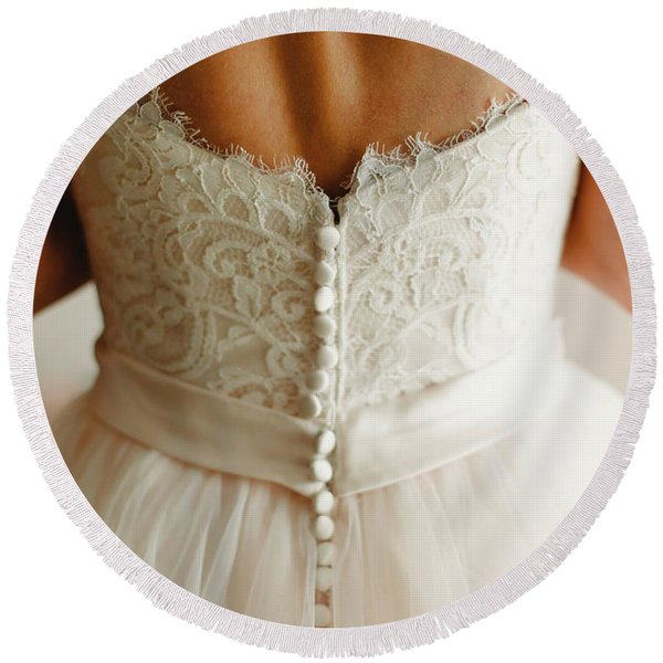 Bride Getting Ready, They Help Her By Buttoning The Buttons On The Back Of Her Dress. Round Beach Towel