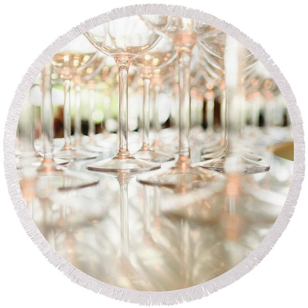 Group Of Empty Transparent Glasses Ready For A Party In A Bar. Round Beach Towel