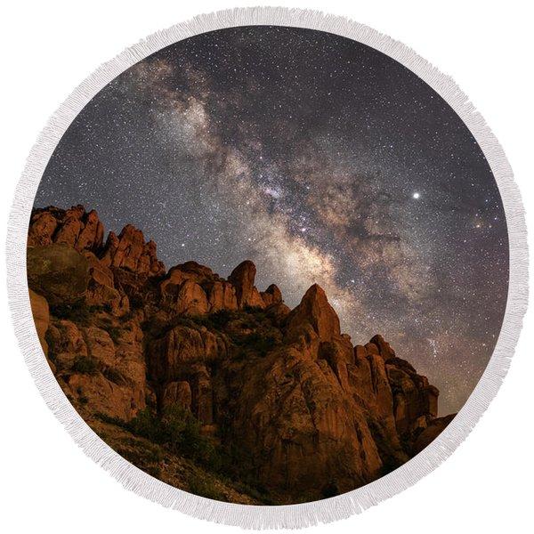 Milky Way Over Rocky Terrain Round Beach Towel