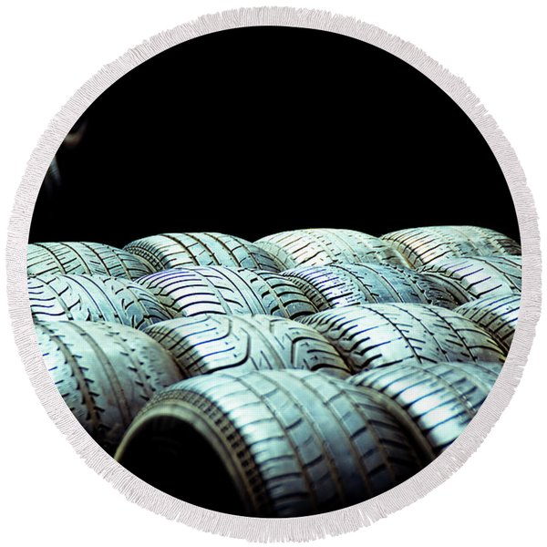 Old Tires And Racing Wheels Stacked In The Sun Round Beach Towel