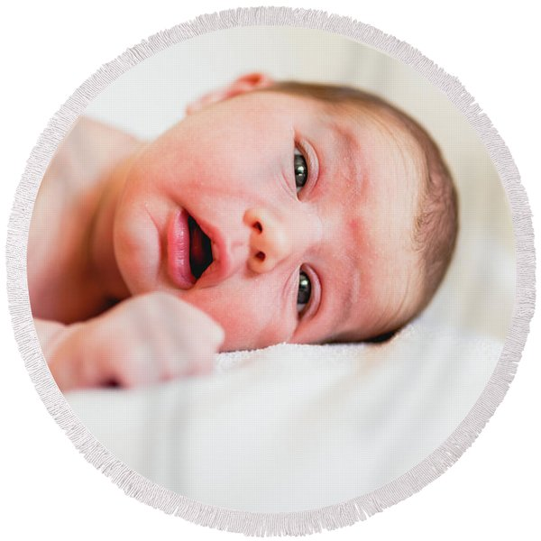 Portrait Of Newborn Baby Girl Feels Safe And Awake To A New Life. Round Beach Towel