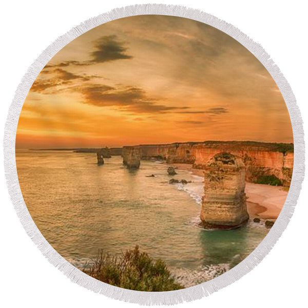 Sunset At The Twelve Apostles Round Beach Towel