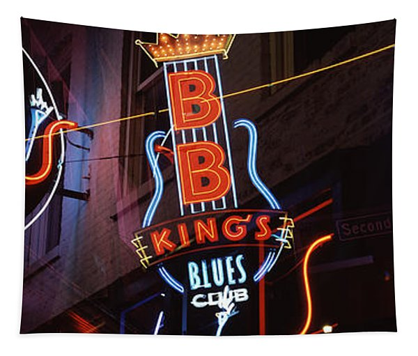 Low Angle View Of Neon Signs Lit Tapestry