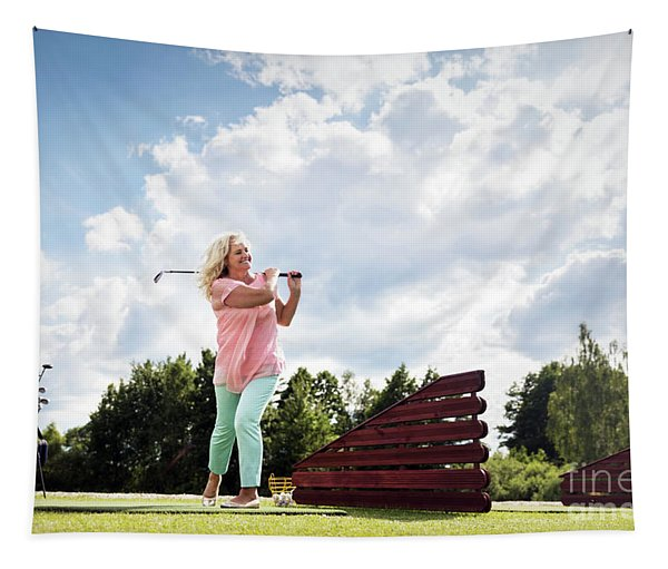 Active Senior Woman Playing Golf. Tapestry
