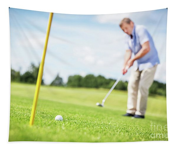 Senior Man Putting A Ball In The Hole. Tapestry