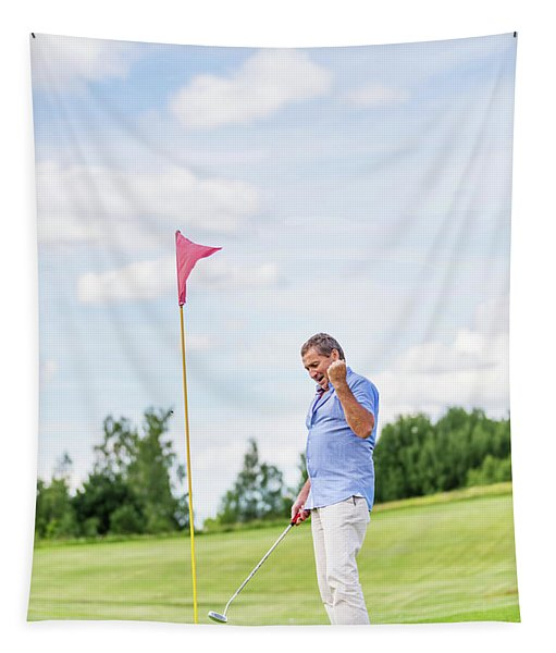 Senior Man Winning Game On A Golf Course. Tapestry