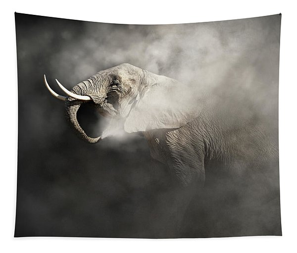 Vulnerable African Elephant In The Dust Tapestry