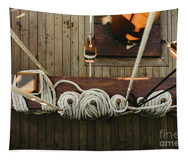 Ropes To Hold The Sails Of An Old Sailboat Rolled. Tapestry