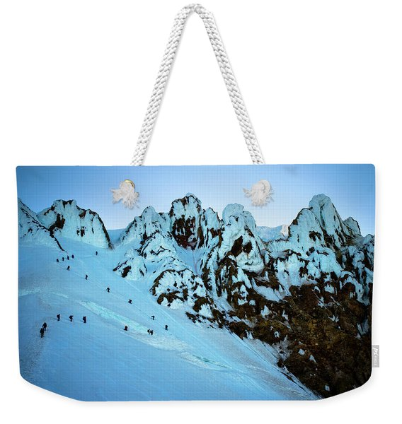 A Large Group Of Mountaineers Ascend Weekender Tote Bag