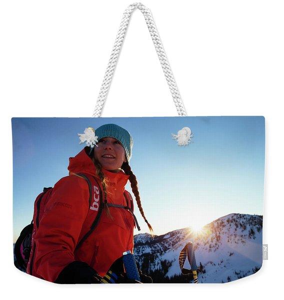 A Woman Backcountry Skiing Weekender Tote Bag