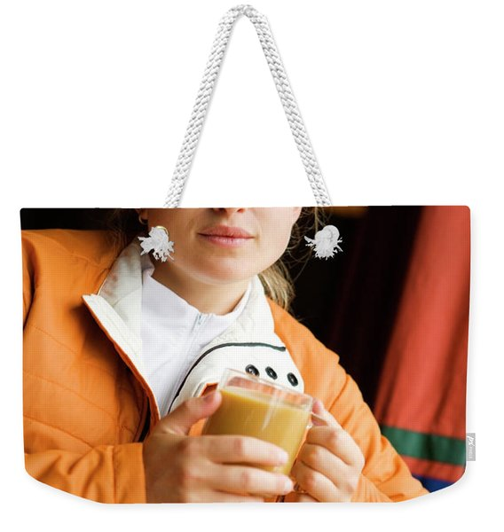 A Woman Enjoys A Warm Cup Of Cocoa Weekender Tote Bag