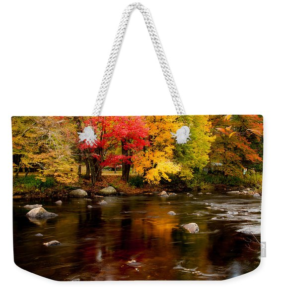 Weekender Tote Bag featuring the photograph Autumn Colors Reflected by Jeff Folger