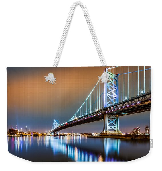 Weekender Tote Bag featuring the photograph Ben Franklin Bridge And Philadelphia Skyline By Night by Mihai Andritoiu