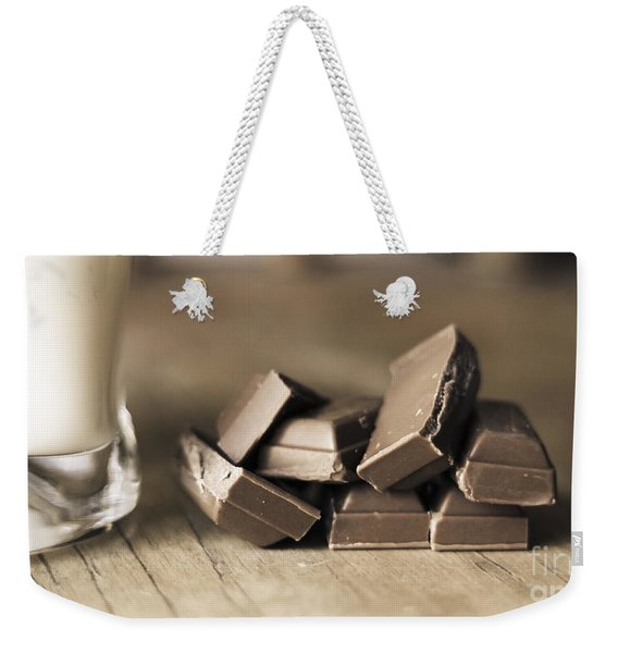 Chocolate Pieces Sitting On Wooden Kitchen Bench Weekender Tote Bag