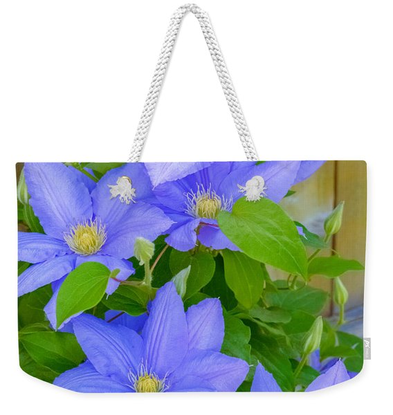 Weekender Tote Bag featuring the photograph Clematis  by Garvin Hunter