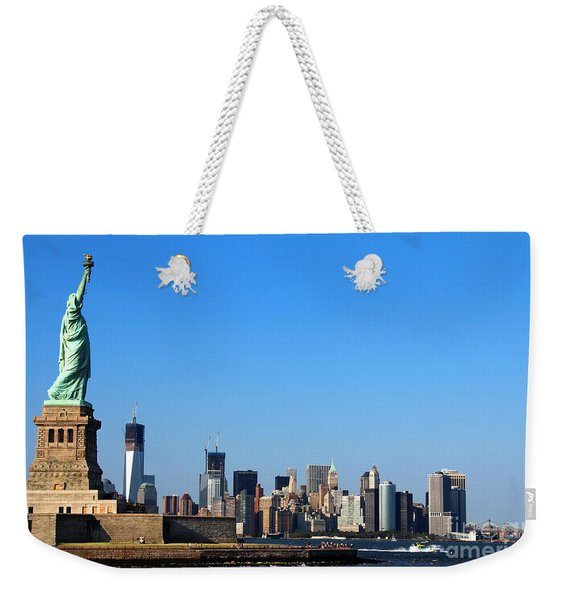 Weekender Tote Bag featuring the photograph Lady Liberty Watches 1wtc Rise by Jemmy Archer