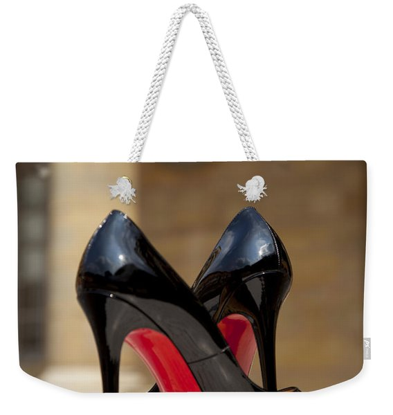 Weekender Tote Bag featuring the photograph Louboutin Heels by Brian Jannsen