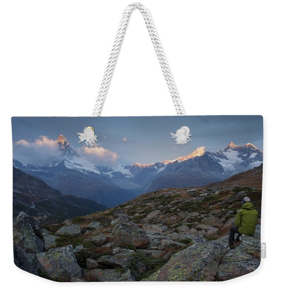 Man Sitting On Rock And Looking Weekender Tote Bag