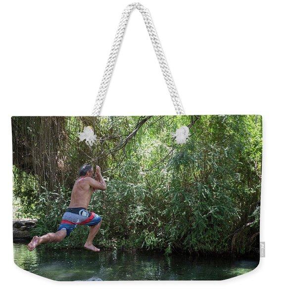 Mature Man Swings From Tree On Rope Weekender Tote Bag
