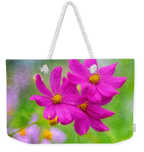 Weekender Tote Bag featuring the photograph Summer Garden by Garvin Hunter
