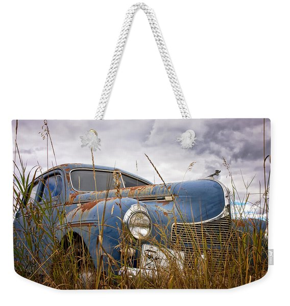 Weekender Tote Bag featuring the photograph 1940 Dodge 4 Door Luxury Liner by Mary Lee Dereske