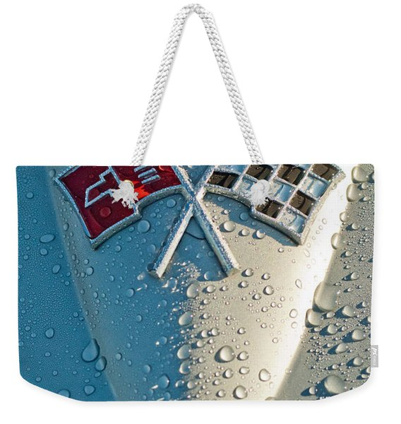 Weekender Tote Bag featuring the photograph 1966 Chevrolet Corvette Sting Ray Hood Emblem by Jill Reger