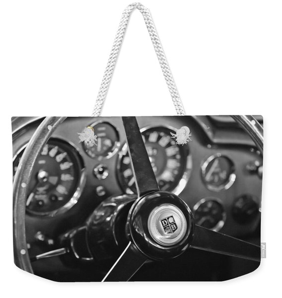 Weekender Tote Bag featuring the photograph 1968 Aston Martin Steering Wheel Emblem by Jill Reger