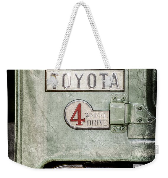 Weekender Tote Bag featuring the photograph 1969 Toyota Fj-40 Land Cruiser Taillight Emblem -0417ac by Jill Reger