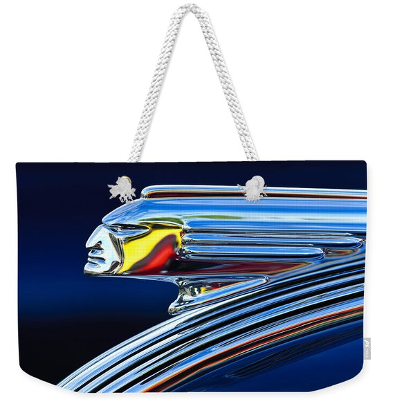 Weekender Tote Bag featuring the photograph 1939 Pontiac Silver Streak Chief Hood Ornament by Jill Reger