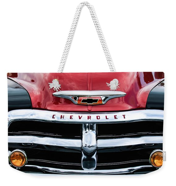 Weekender Tote Bag featuring the photograph 1955 Chevrolet 3100 Pickup Truck Grille Emblem by Jill Reger