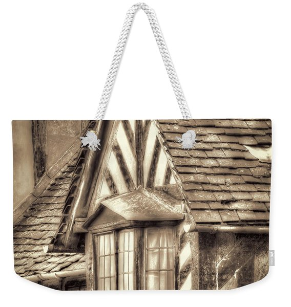 Weekender Tote Bag featuring the photograph Tudor Style Buildings by Susan Leonard
