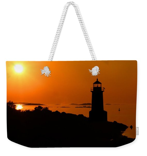 Weekender Tote Bag featuring the photograph Winter Island Lighthouse Sunrise by Jemmy Archer
