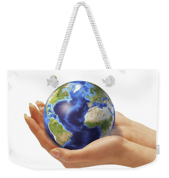 Womans Hands Holding An Earth Globe Weekender Tote Bag