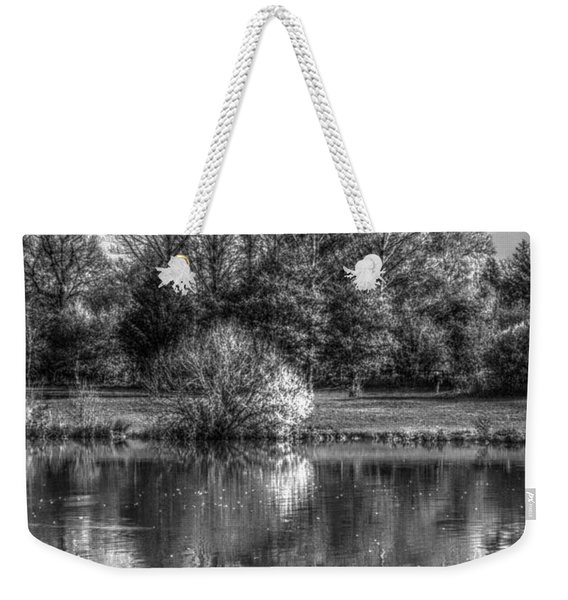 Weekender Tote Bag featuring the photograph Lake Reflections by Jeremy Hayden