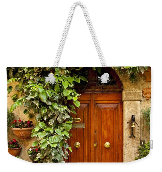 Weekender Tote Bag featuring the photograph Tuscan Door by Brian Jannsen