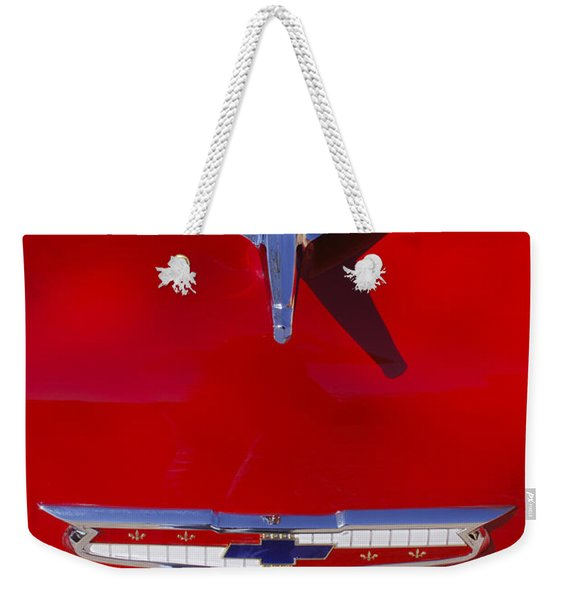 Weekender Tote Bag featuring the photograph 1955 Chevrolet Belair Nomad Hood Ornament by Jill Reger