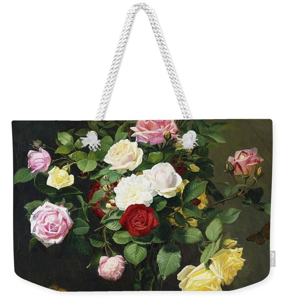 A Bouquet Of Roses In A Glass Vase By Wild Flowers On A Marble Table Weekender Tote Bag