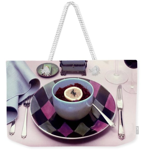 A Bowl Of Food On A Pink Table Weekender Tote Bag