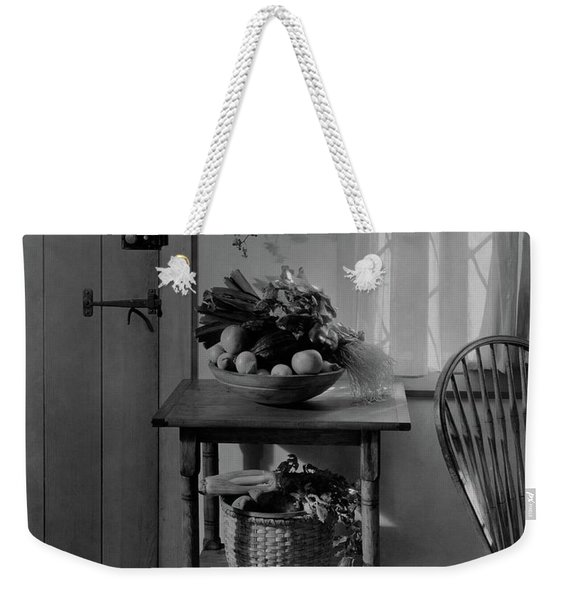 A Bowl Of Vegetables On A Table Weekender Tote Bag