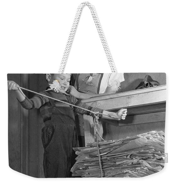 A Boy Recycling Newspaper Weekender Tote Bag