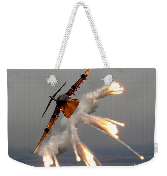 A C-17 Globemaster IIi Releases Flares Weekender Tote Bag