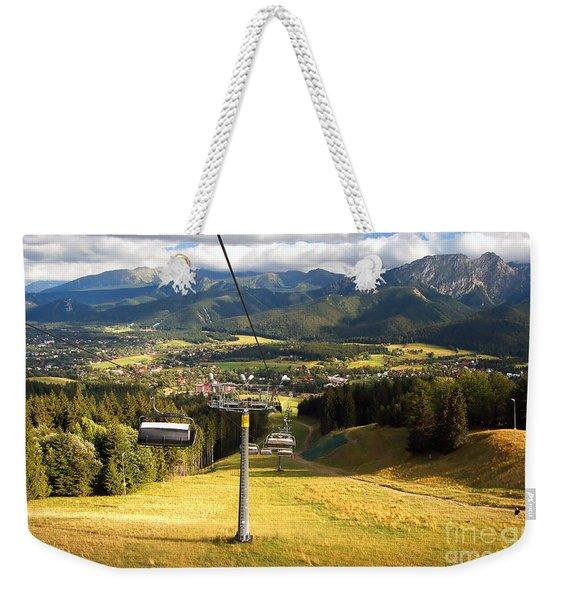 A Chair-lift Weekender Tote Bag
