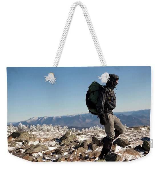 A Climber Descends From The Summit Weekender Tote Bag