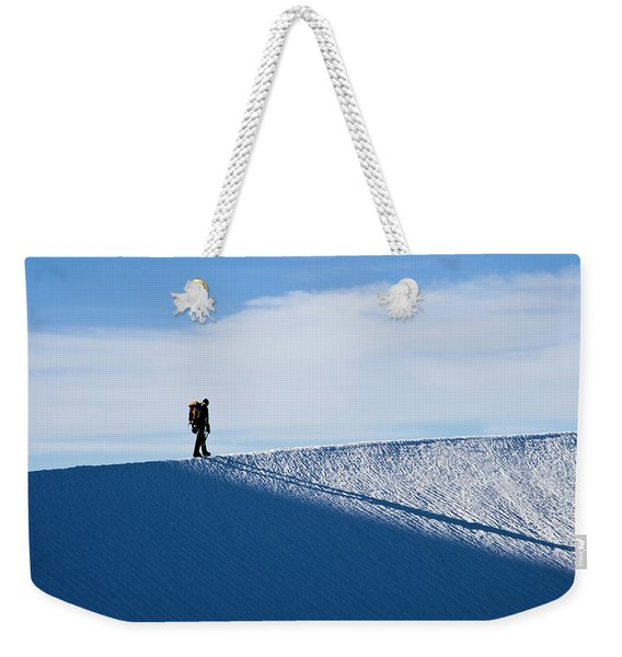 A Climber Hikes Into The Sun While Weekender Tote Bag
