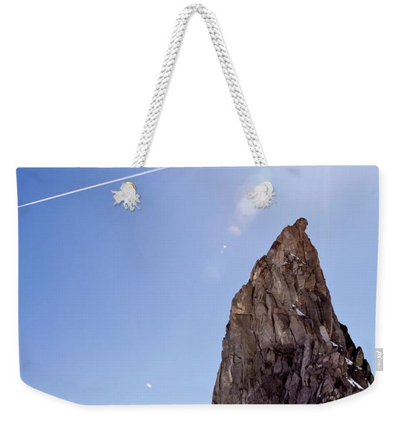 A Climber Hikes On A Snowy Ridge Weekender Tote Bag