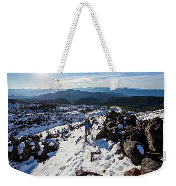 A Climber Moves Uphill Through The Snow Weekender Tote Bag