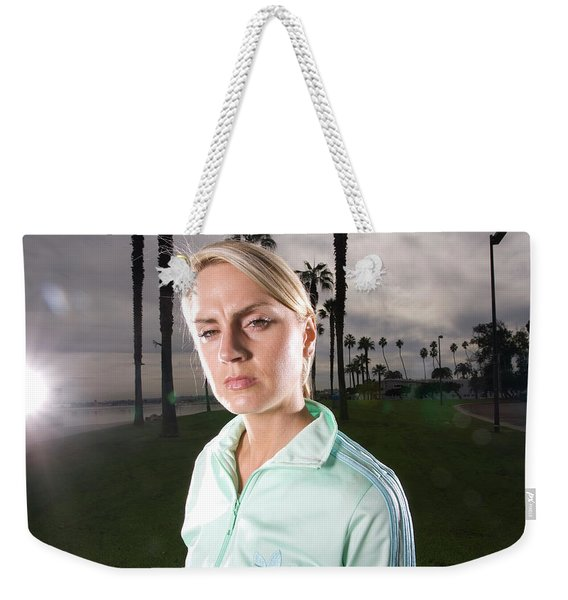 A Female Athlete Stands In Park Weekender Tote Bag