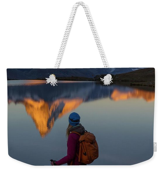 A Female Hiker Is Standing Weekender Tote Bag