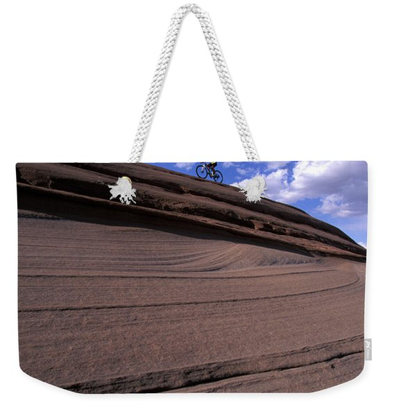A Female Mountain Biker Mountain Biking Weekender Tote Bag
